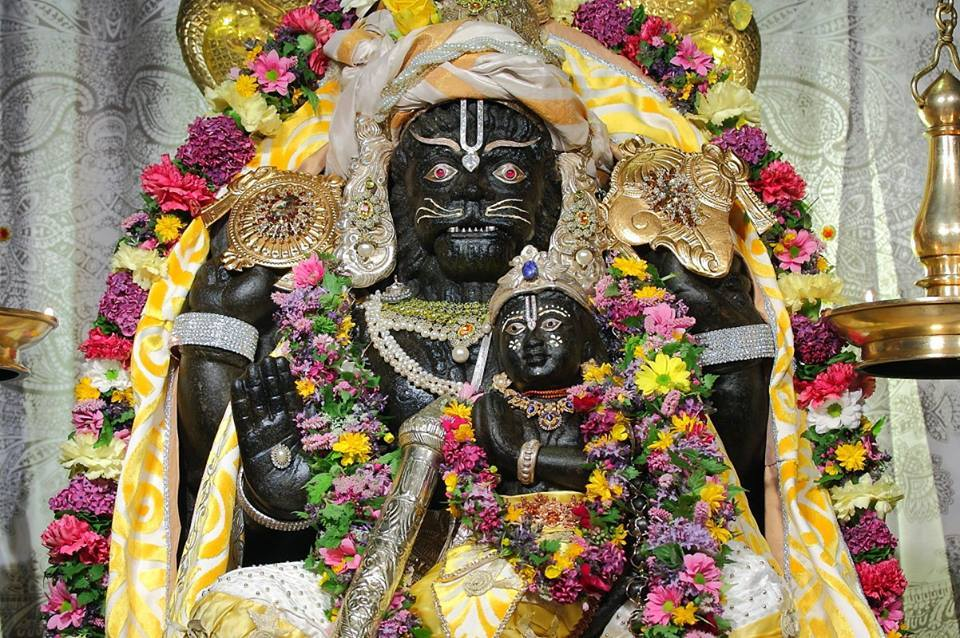Narasimha showing fatherly love to child devotee Prahlad